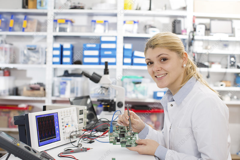Lab assistant using a circuit board