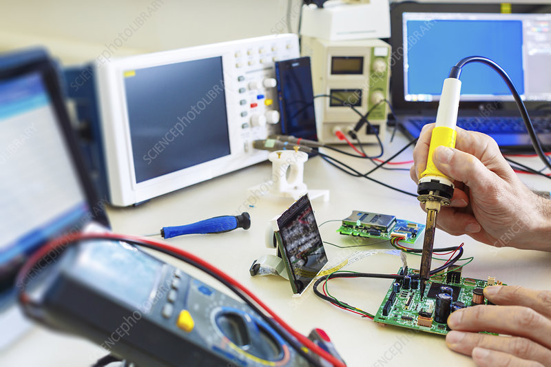 Person working in an electronics lab