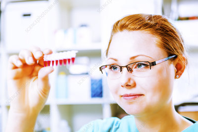 Lab assistant holding micro tubes
