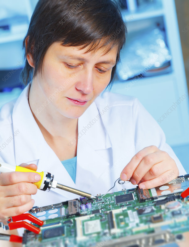 Lab assistant working on circuit board