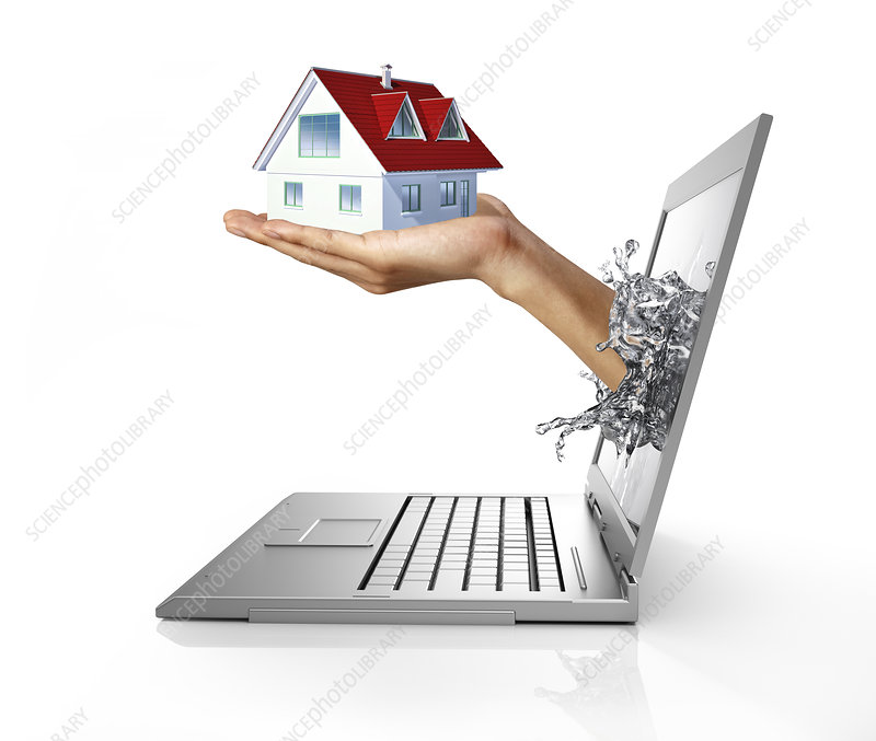 Laptop with hand holding model house