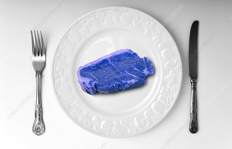 Blue meat on white plate