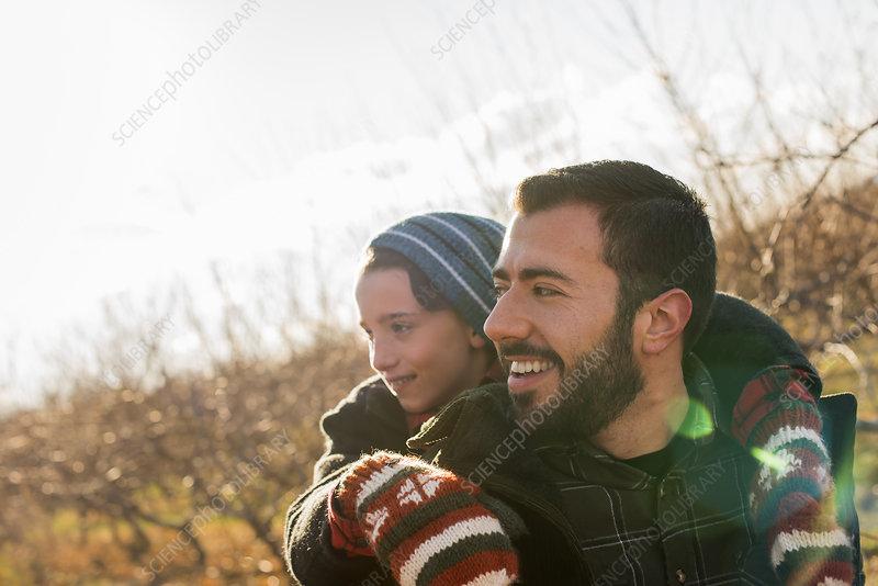 A man with a child riding piggyback