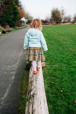 Child walking on a log