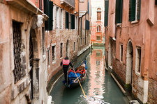 A gondola boat on a narrow waterway