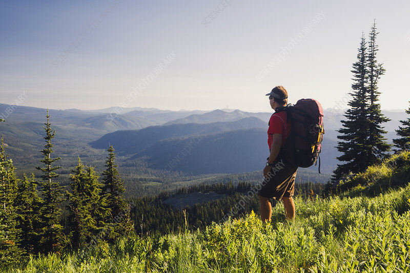 Man backpacking in the mountains