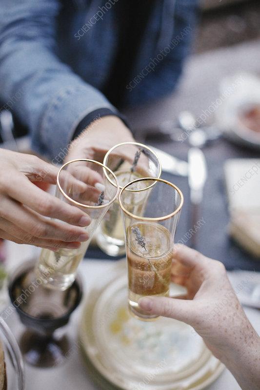 Three people making a toast