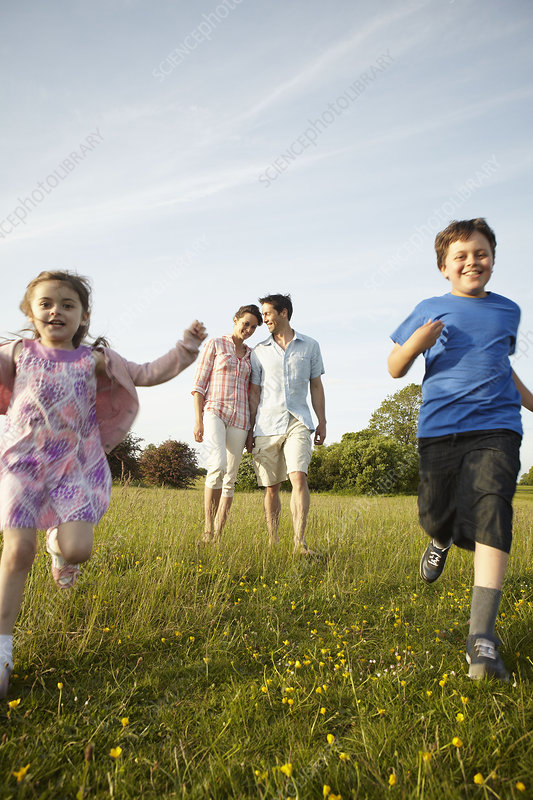 A family outdoors in the summer