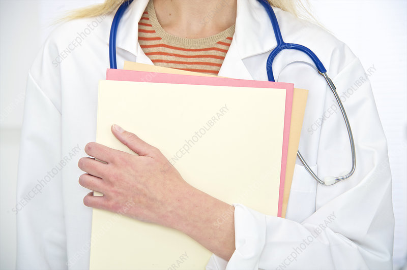 Doctor with stethoscope and notes