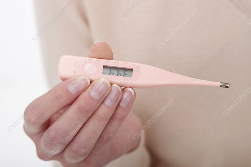 Woman reading her temperature