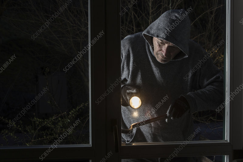 Man breaking into building