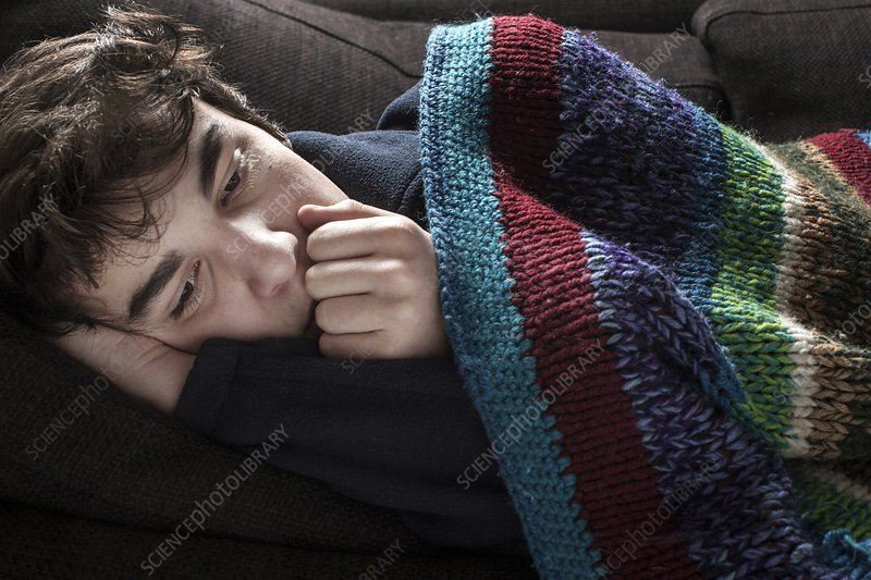 Young man in blanket