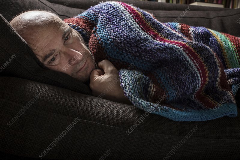 Mature man in blanket