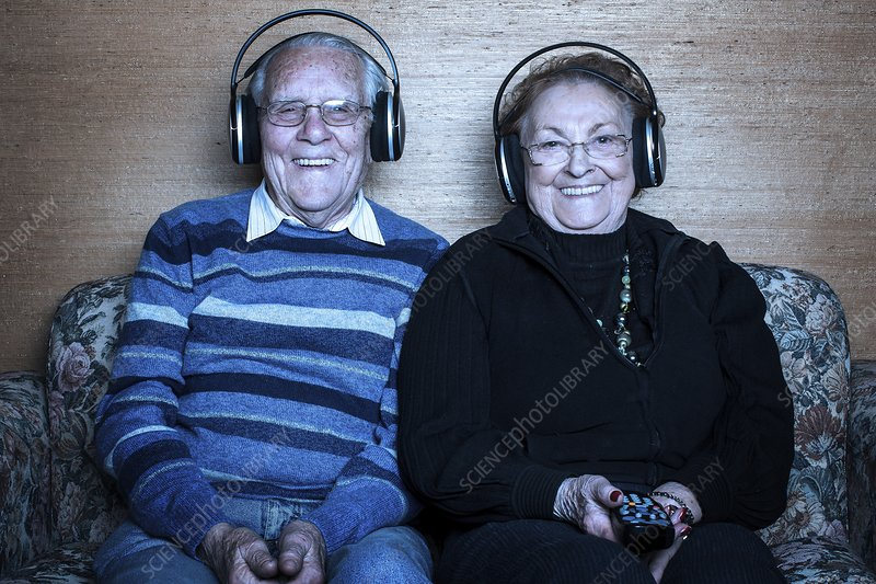 Senior couple wearing headphones