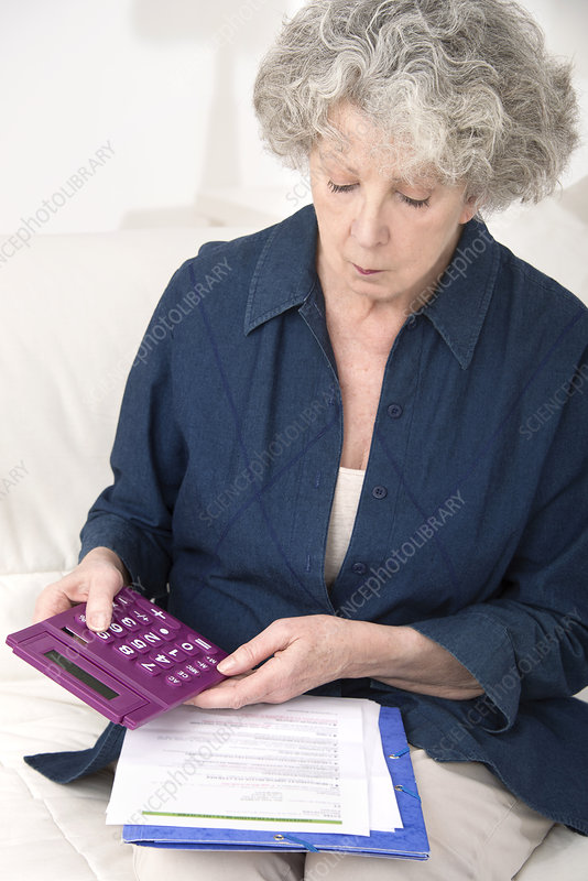Woman using calculator
