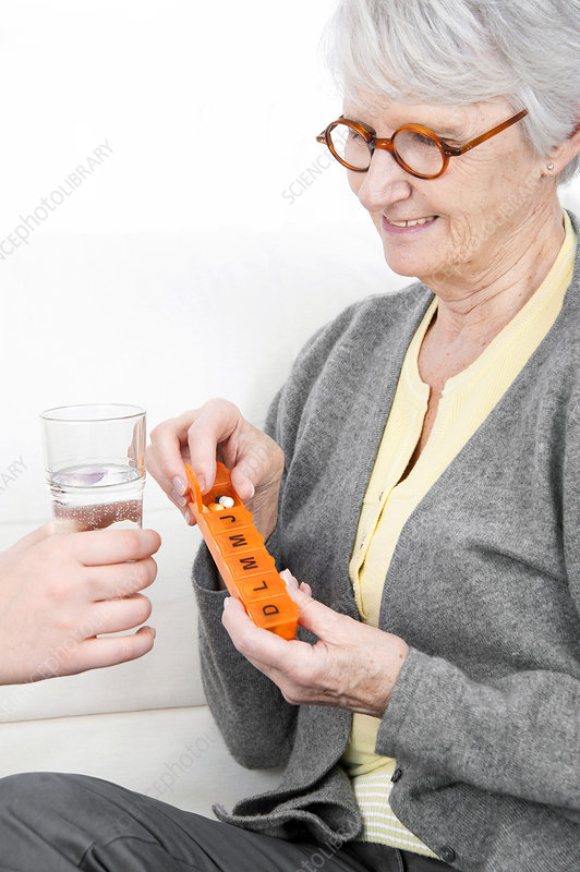 Woman holding pill container