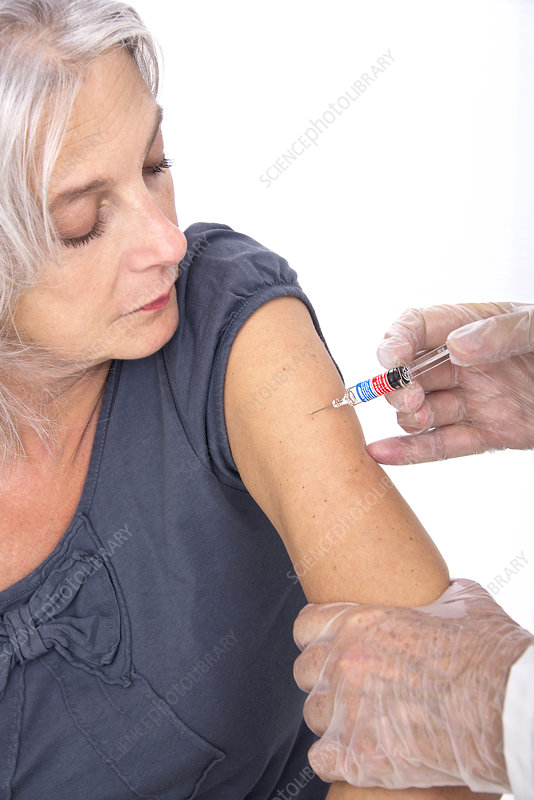 Mature woman receiving vaccination