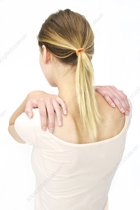 Woman with hands on shoulders