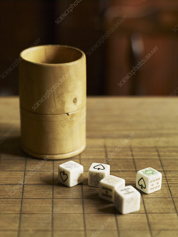 Five dice on a pub table