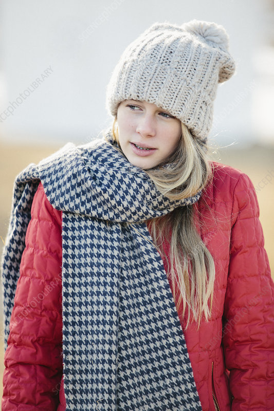 A girl in a red jacket and scarf