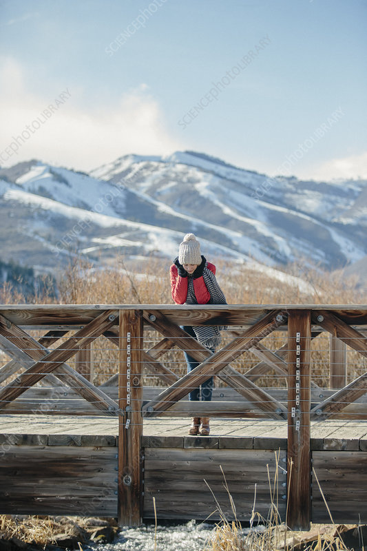 A girl in a red jacket in a woolly hat