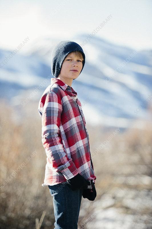 A boy with woolly hat and checked shirt