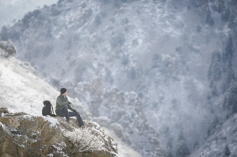 A man, a hiker in the mountains