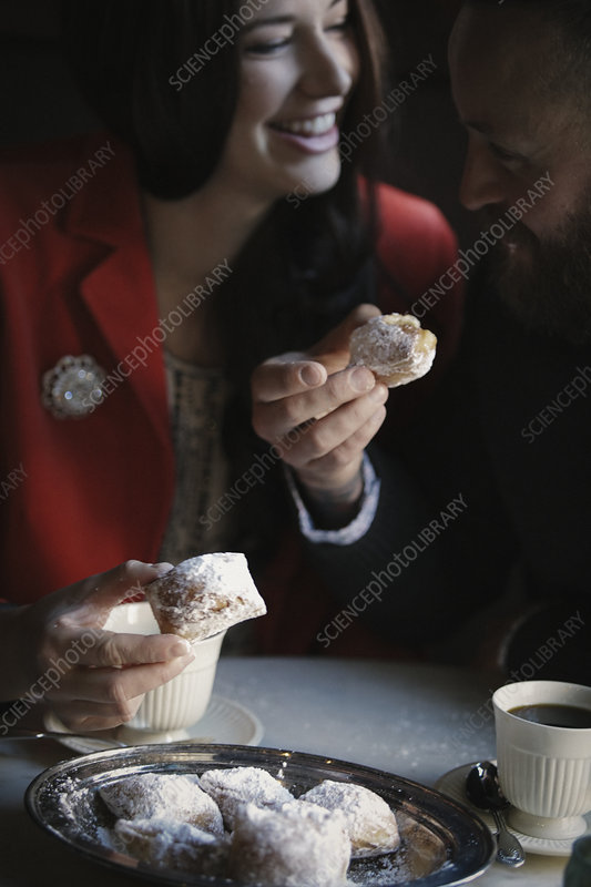 A couple seated having coffee