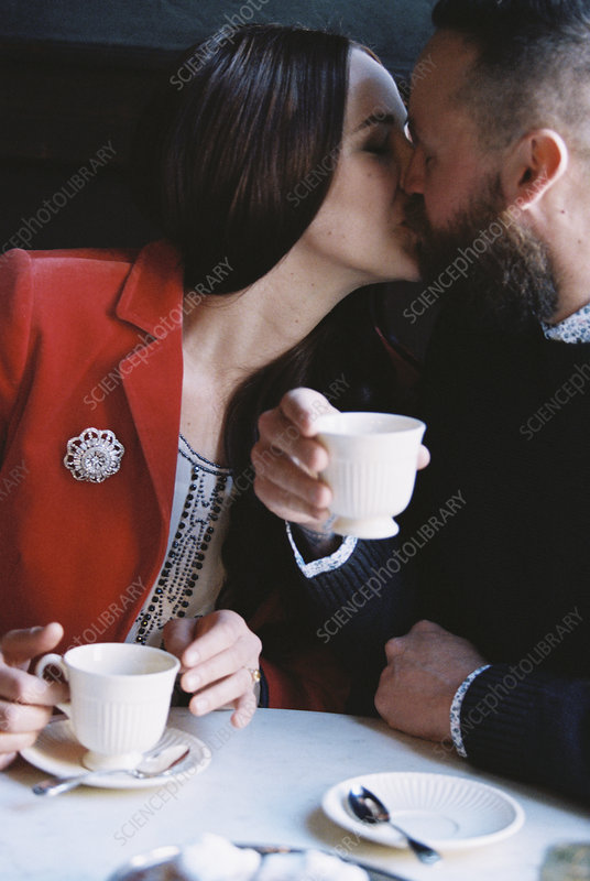 A couple seated kissing