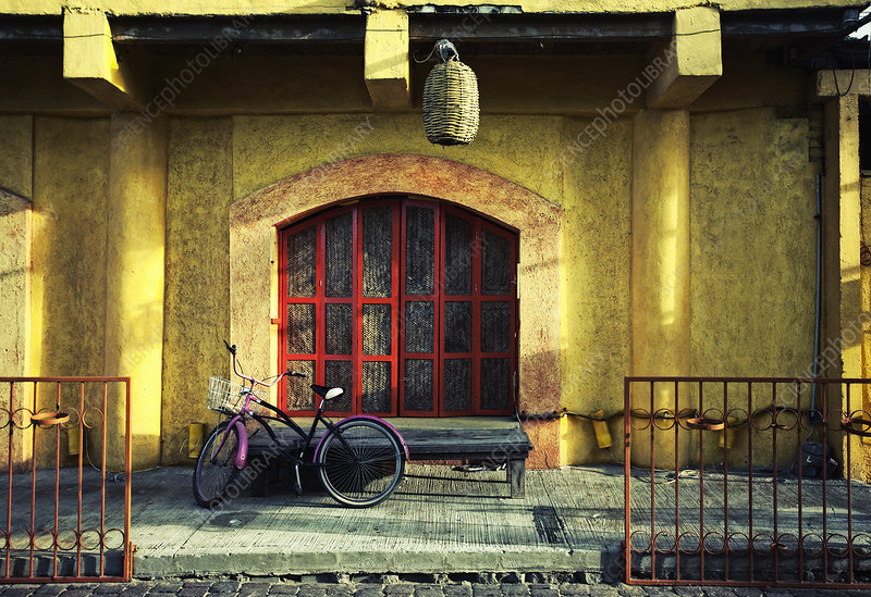 A bicycle by a caf in a Mexican town