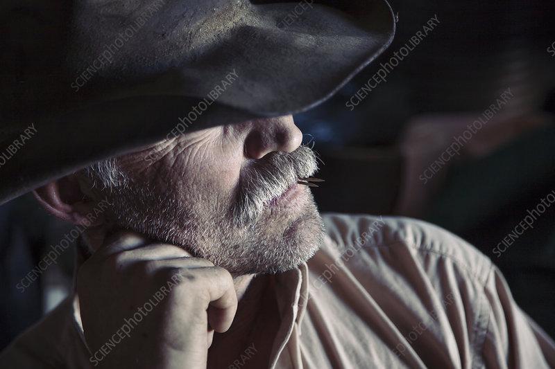 A man wearing a brimmed hat