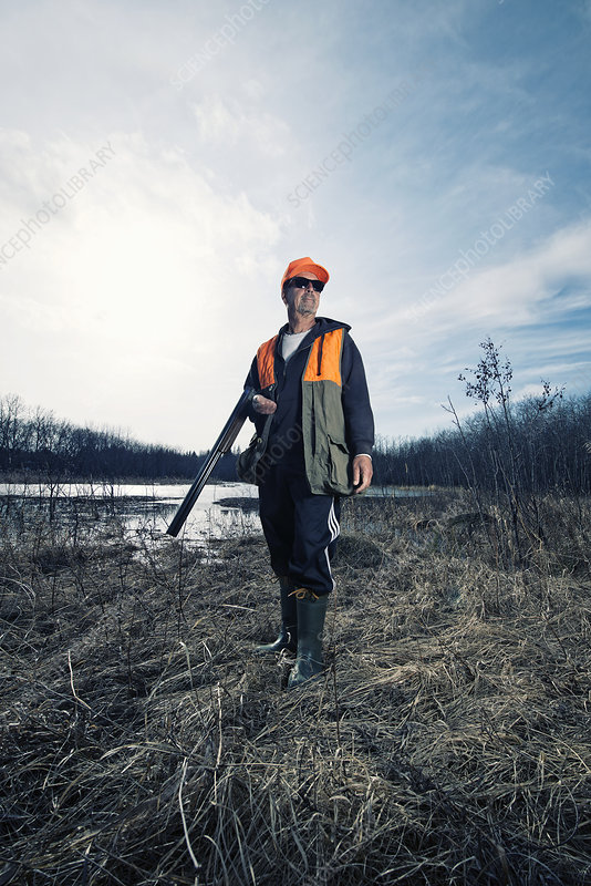 A man holding a hunting rifle