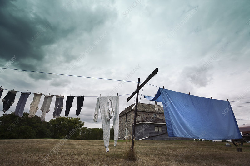 A washing line with clothes and sheets