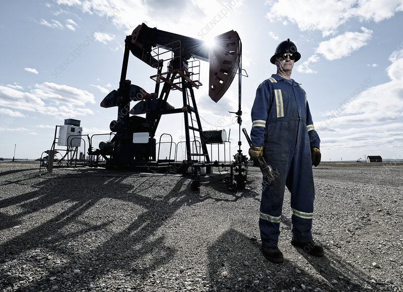 A man working at a pump jack