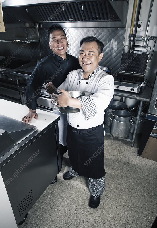 Two cooks in a commercial kitchen