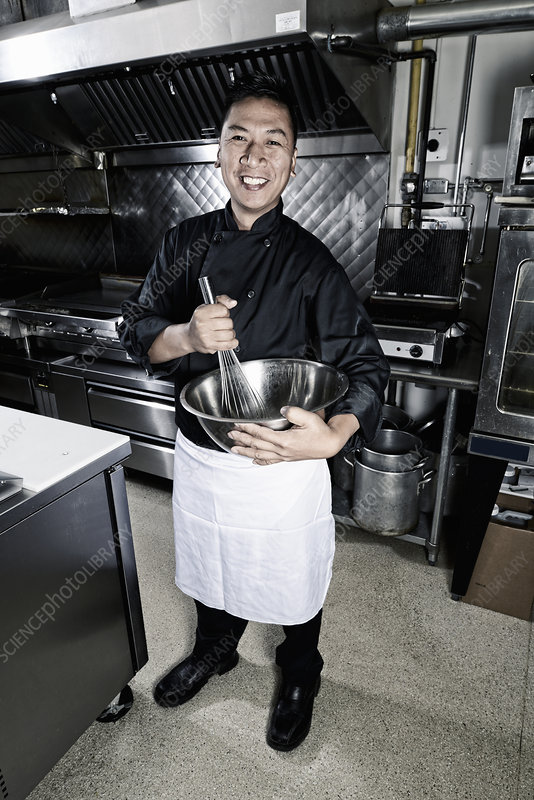 A cook in a commercial restaurant