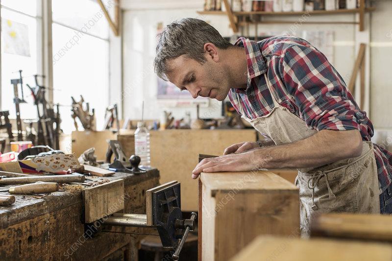 A furniture restorer in his workshop