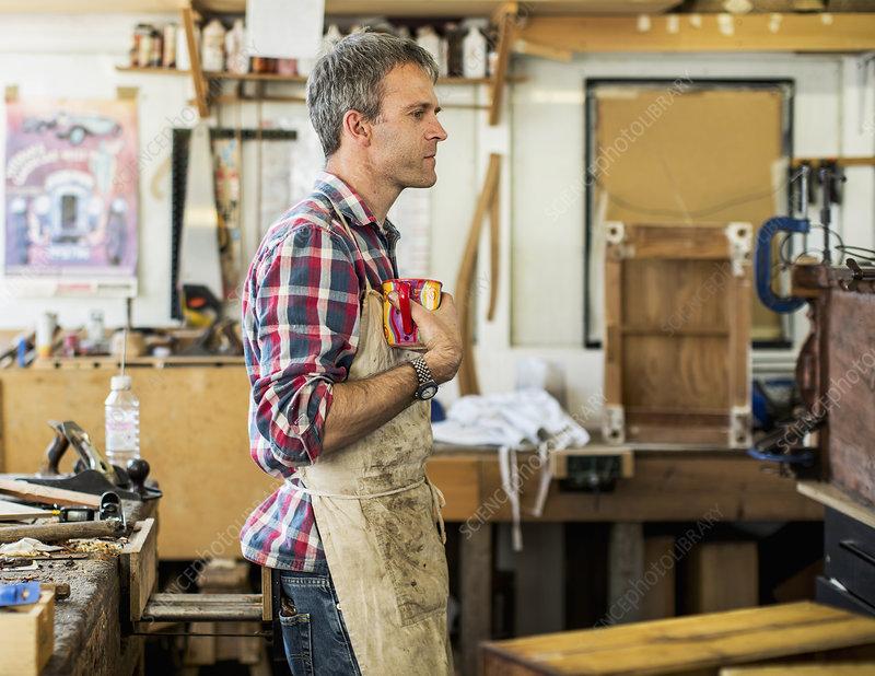 Furniture restorer on a coffee break