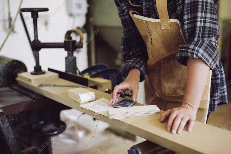 Craftswoman in pipe organ workshop