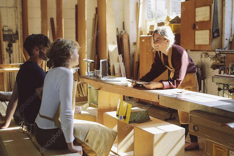 Workers in pipe organ workshop