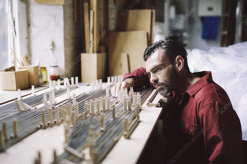 Craftsman in pipe organ workshop