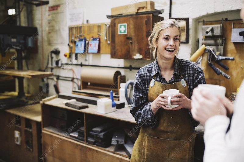 Craftswomen in pipe organ workshop