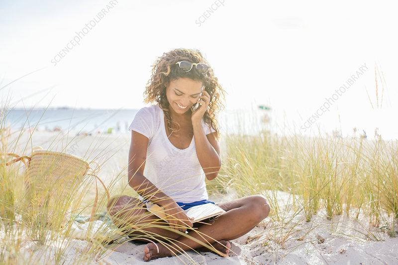Woman cross legged reading a book