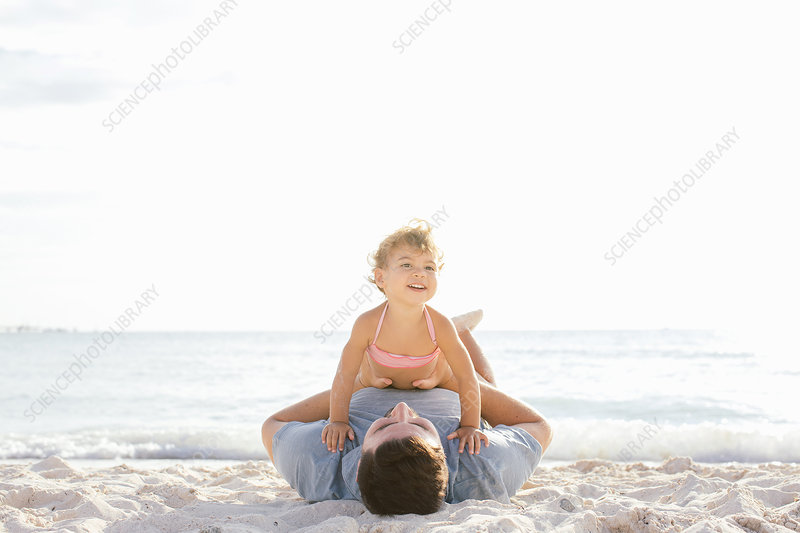 Toddler sitting on top of father