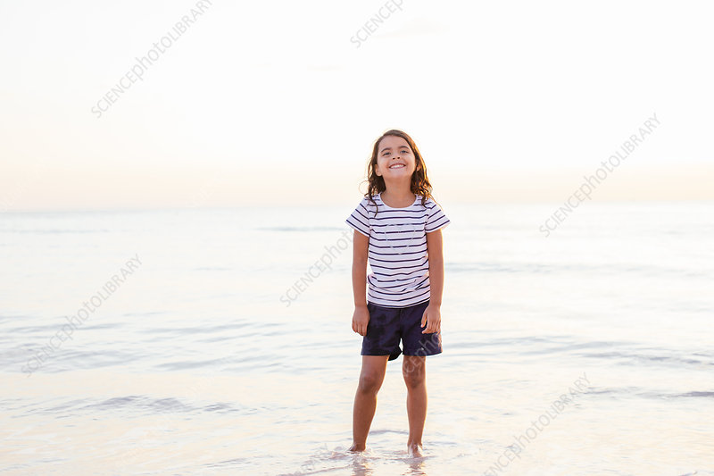Portrait of girl in sea, Tuscany, Italy