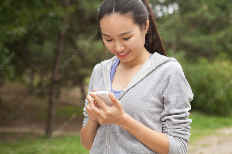 Runner selecting music from smartphone