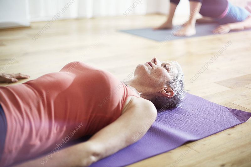 Woman lying on back in pilates class