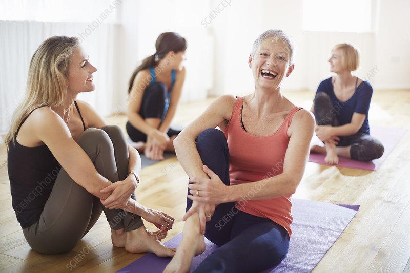 Women sitting on floor in pilates class