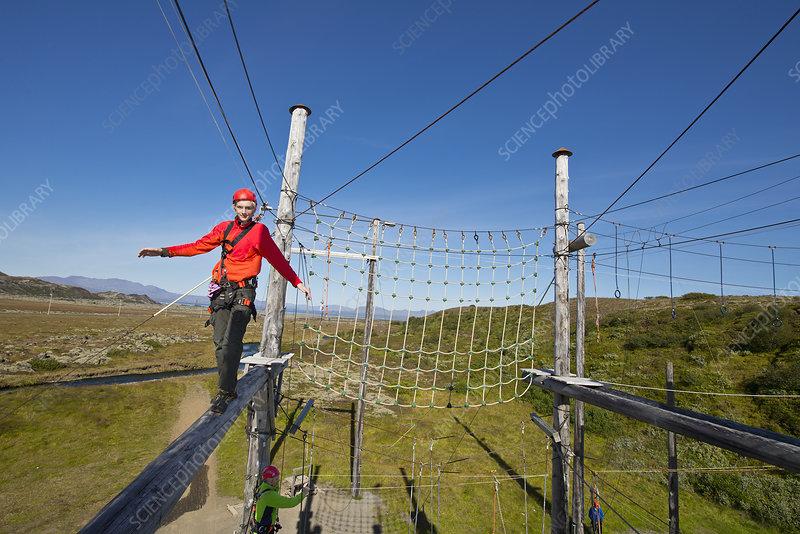 Teenage boy on high rope course