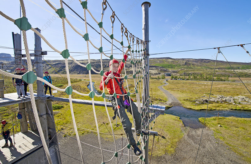 Teenage boy at high rope course
